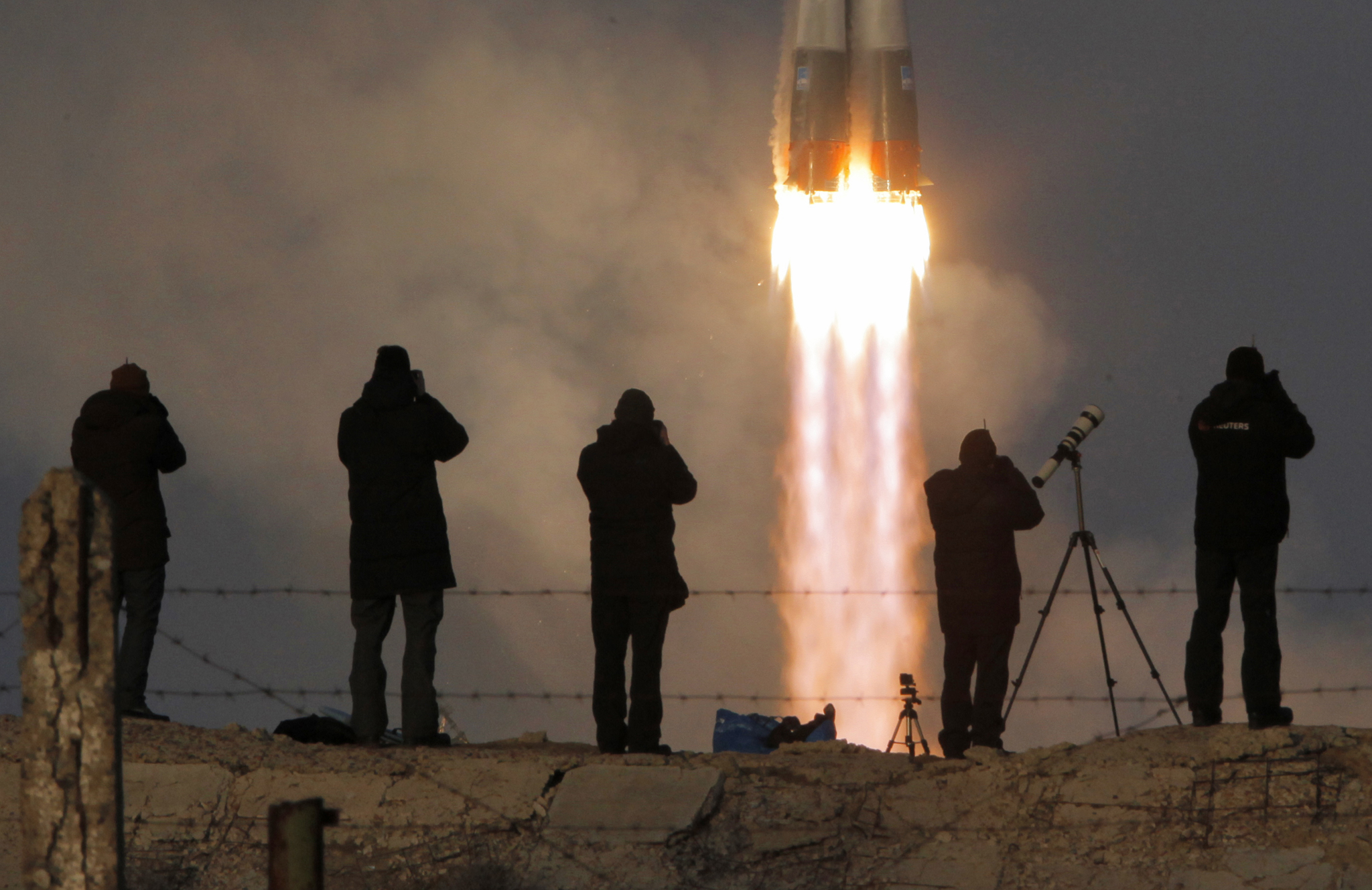 Photo © Dmitry Lovetsky / AP| Baikonur Cosmodrome | The Soyuz-FG rocket booster with Soyuz TMA-19M space ship carrying a new crew to the International Space Station, ISS, blasts off at the Russian leased Baikonur in Kazakhstan.