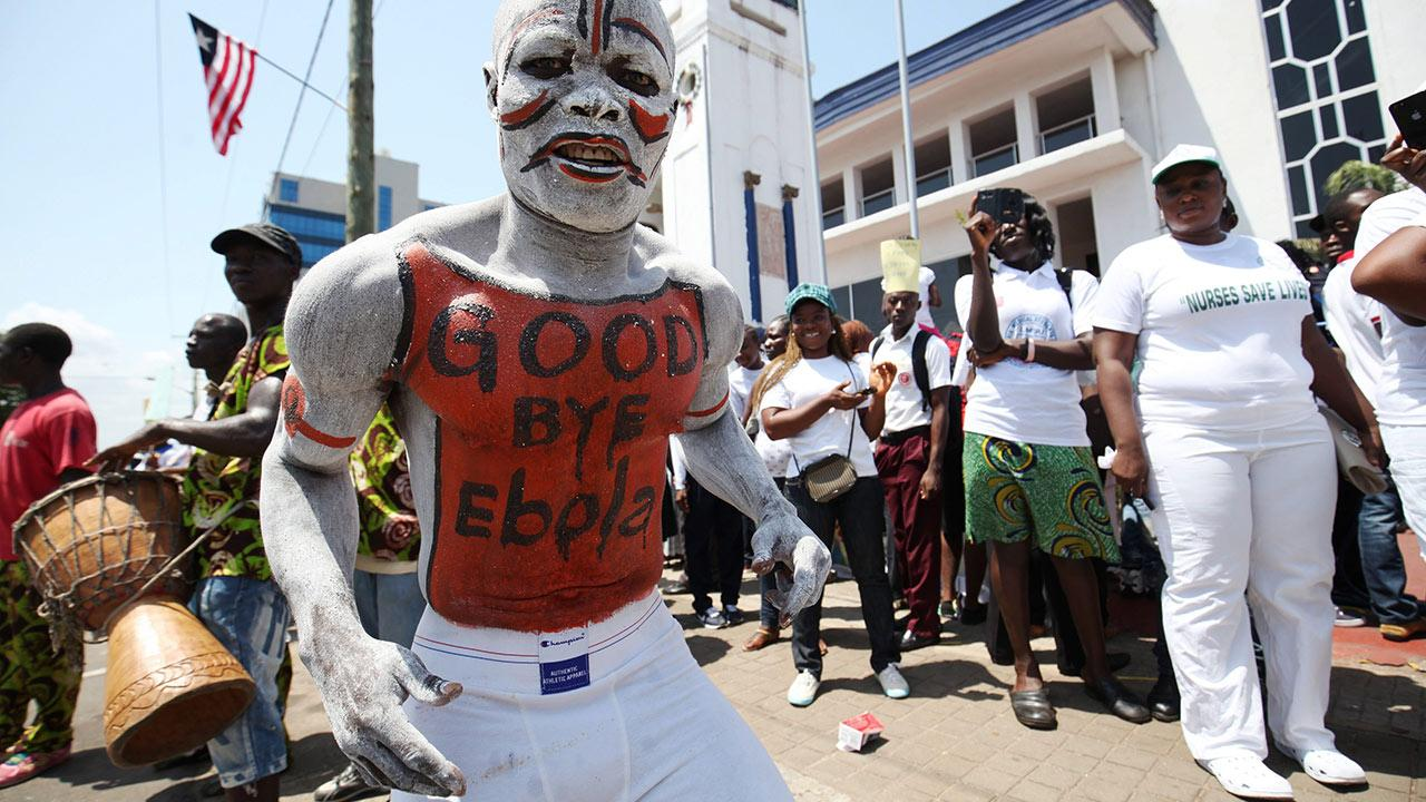 Photo © EPA / Ahmed Jallanzo | When Liberia was declared free of Ebola in May 2015, people celebrated in the streets